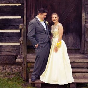 Light yellow prom dress with beaded torso and back